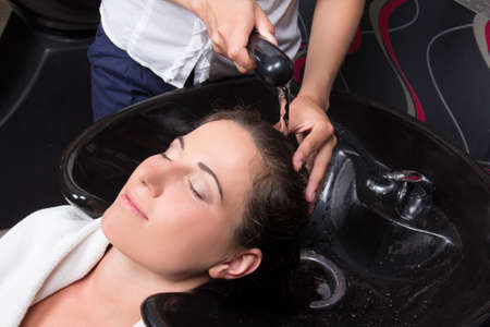 salon spa: young beautiful woman getting a hair wash in beauty salon Stock Photo