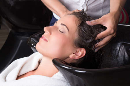 young attractive woman getting a hair wash in beauty salon