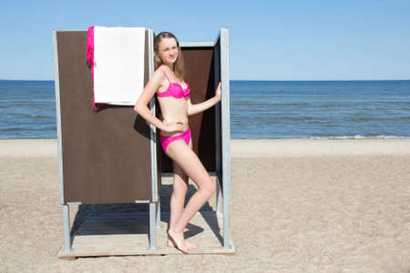 young slim beautiful woman in cubicle on the beach photo