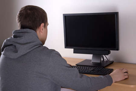 teenager using a personal computer at home photo