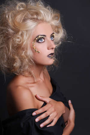 beautiful daydreaming girl with creative make up and coiffure photo