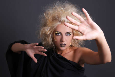 psychic: portrait of beautiful psychic with creative make up and coiffure