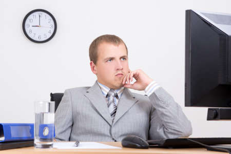 tired business man sitting at workplace