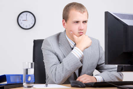 young business man having a problem at work photo