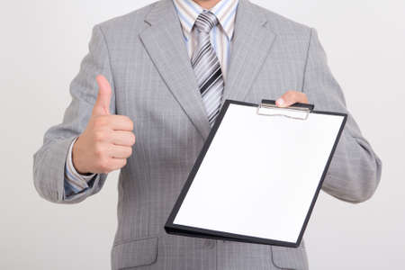 young business man with contract thumbed up photo