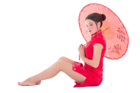 woman in red japanese dress with umbrella isolated on white background photo