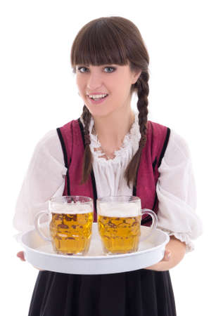 Beautiful waitress in bavarian dress with beer over white photo