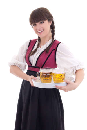 Cute waitress in bavarian dress with beer over white photo
