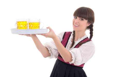 Happy waitress in bavarian dress with beer over white photo