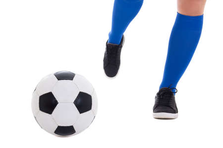 gaiters: leg of soccer player in blue gaiters kicking ball isolated on white background Stock Photo