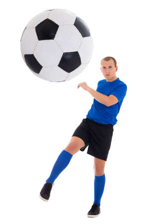 soccer player in blue uniform kicking ball isolated on white background photo
