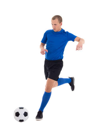 soccer player in blue kicking leather ball isolated on white background