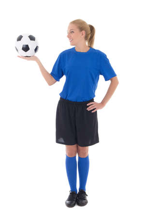 young female soccer player in blue uniform holding the ball isolated on white background photo