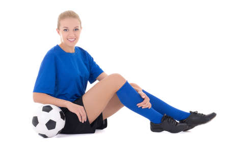women playing soccer: sexy female soccer player in blue uniform sitting with ball isolated on white background