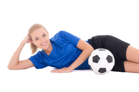 young sexy female soccer player in blue uniform lying with ball isolated on white background
