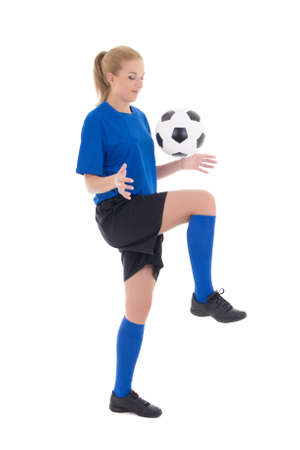 young female soccer player in blue uniform playing with ball isolated on white background Stock Photo