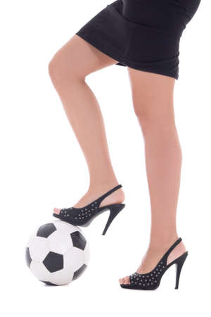 women playing soccer: Sexy woman legs with high heels and soccer ball isolated on white background