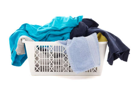 colorful dirty clothes in a laundry basket isolated on white background