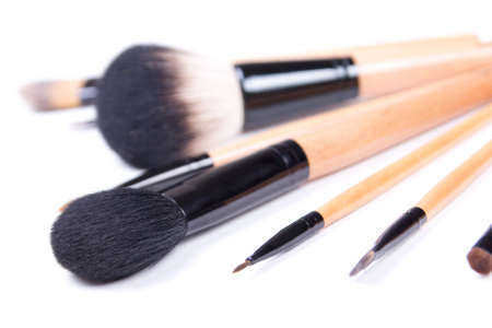 close up of professional make-up brushes over white background photo