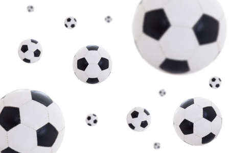 flying leather soccer balls isolated on white background photo