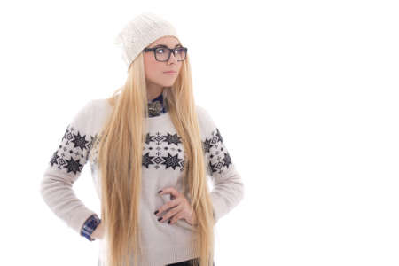 attractive young woman with long hair in warm winter clothes isolated on white background photo