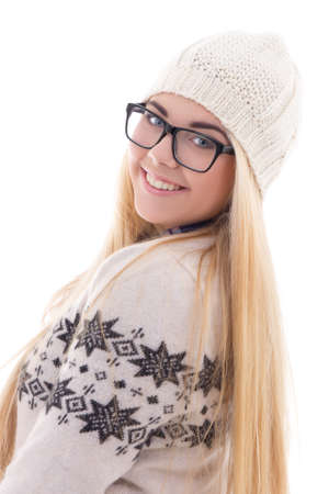 attractive smiling teenage girl with beautiful long hair in warm winter clothes isolated on white background photo