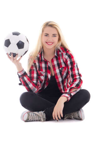 beautiful teenage girl in eyeglasses sitting with soccer ball isolated on white background photo