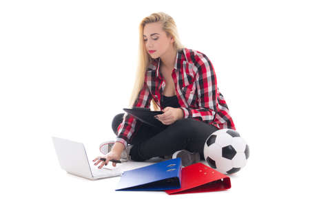 blondie woman sitting with laptop, folders and soccer ball isolated on white background photo