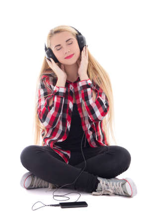 young happy blondie woman listening music in earphones isolated on white background Stock Photo - 22809430