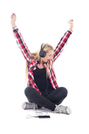 happy teenage girl listening music in earphones isolated on white background Stock Photo - 22809433