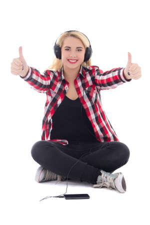 happy teenage girl listening music in earphones and thumbs up isolated on white background photo