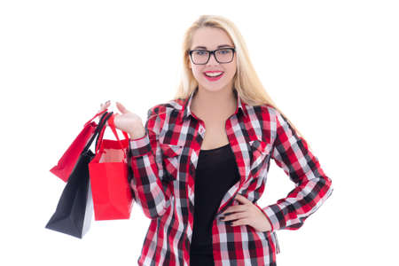 attractive teenage girl  in eyeglasses with shopping bags isolated on white background photo