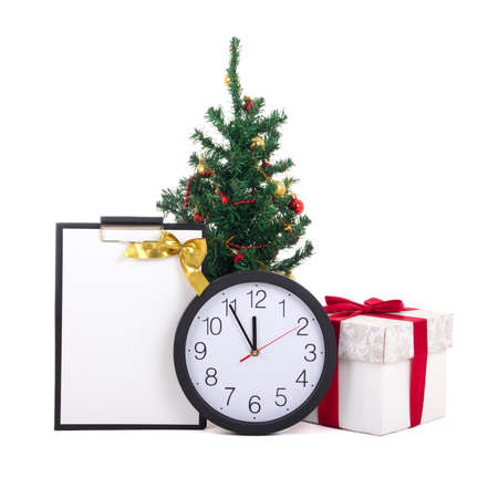 gift box with red ribbon, wish list, christmas tree and clock isolated on white background photo