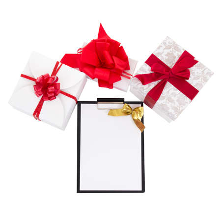 gift boxes with red ribbon and gift list isolated on white background photo