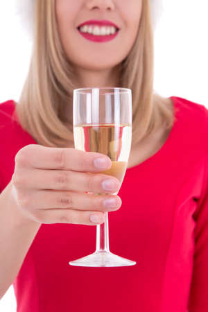 young christmas woman with glass of champagne isolated on white photo