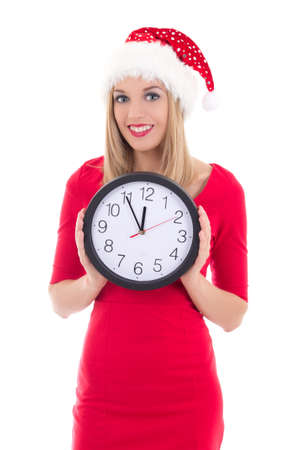 happy woman in santa hat with clock posing isolated on white background photo