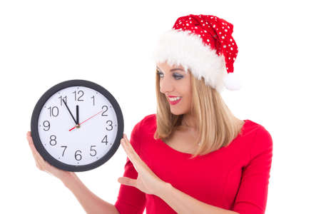 attractive woman in santa hat with clock posing isolated on white background photo