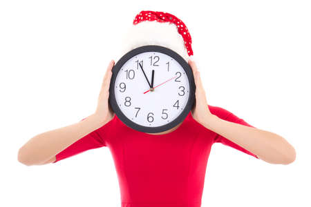 woman in santa hat holding clock over white background photo