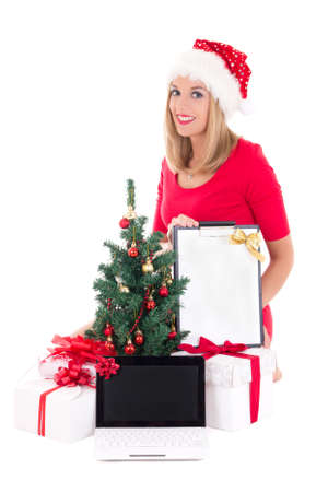 woman with wish list, notebook,  christmas tree and gifts over white photo