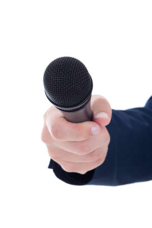 journalists hand holding a microphone isolated on white background photo