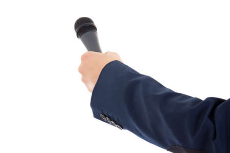 reporters hand holding a microphone isolated over white background photo