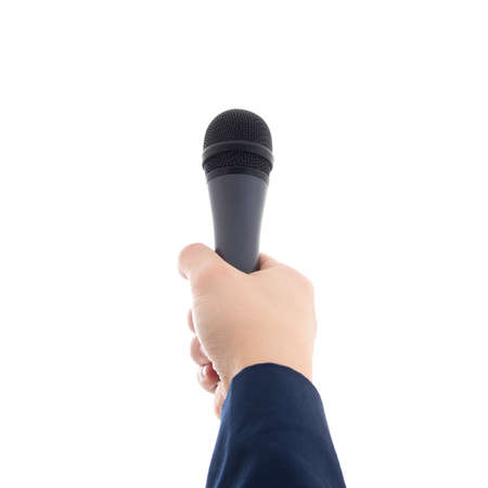 hand holding a microphone isolated on white background Stock Photo
