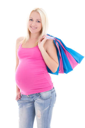 portrait of young attractive pregnant woman with shopping bags isolated on white background
