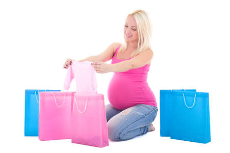 young attractive pregnant woman with shopping bags isolated on white background photo