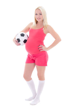 young pregnant woman with soccer ball isolated on white background photo