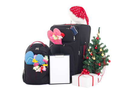 wishlist: christmas trip - suitcase and packpack, giftbox, wishlist and christmas tree isolated on white Stock Photo