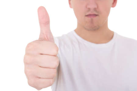 close up portrait of young man in white  t-shirt thumbs up isolated on white photo