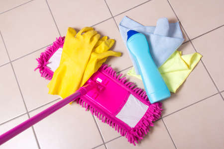 cleaning products: Cleaning products on the tile floor in bathroom