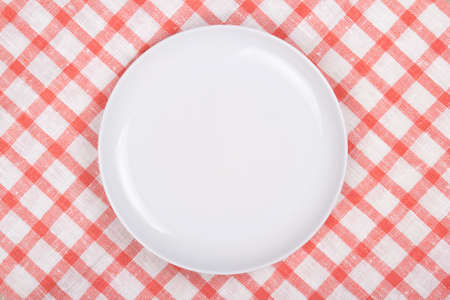checker plate: white empty plate over checkered background Stock Photo
