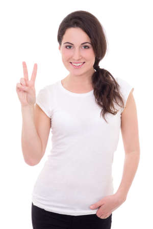 portrait of happy young woman giving peace sign isolated on white background photo